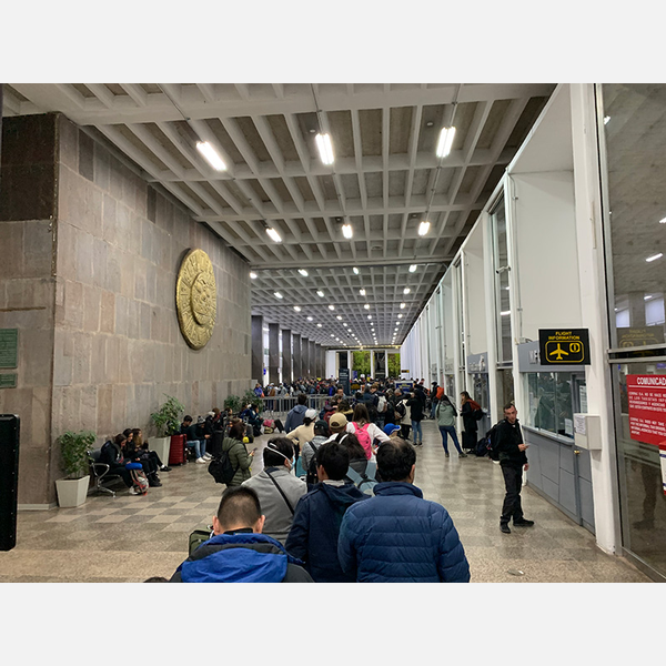 Hundreds of people mass at the airport in Cusco, Peru, trying for a flight out after the government announced the country was being closed due to the coronavirus.
