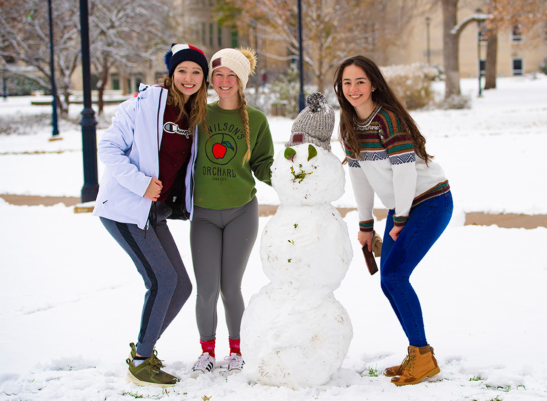 Three girls with snowman